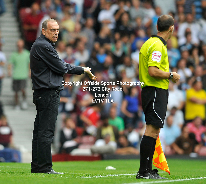 21/08/2010 - Premiership Football - West Ham United vs Bolton Wanderers - Avram Grant has words with linesman. - Photo: Charlie Crowhurst / Offside.