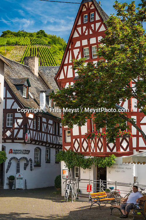 Ediger-Eller, Mosel, Germany, August 2016. Ediger-Eller, once two separate hamlets, is another photogenic wine village with well-preserved houses and remnants of a medieval town wall. It's particularly romantic at night, when the narrow alleys and half-timber buildings are illuminated by historic streetlights. The Moselle river twists and turns its way between Trier and Koblenz along one of Germany's most beautiful valleys. At some places the terraced vineyards are the steepest of all. Some of the best Riesling wine is made here. Castles towering over romantic wine villages line the banks of the river. Photo by Frits Meyst / MeystPhoto.com