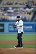 LOS ANGELES, CA - AUGUST 22:  Actor  Jesse Tyler Ferguson, co-star of the comedy television series Modern Family, throws out the celebratory first pitch before the Los Angeles Dodgers game against the New York Mets at Dodger Stadium on Friday, August 22, 2014 in Los Angeles, California. The Dodgers won the game 6-2. (Photo by Paul Spinelli/MLB Photos via Getty Images) *** Local Caption *** Jesse Tyler Ferguson