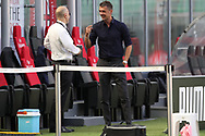 Former AC Milan player and actual Director of Sport Paolo Maldini speaks with AC Milan's Managing Director Ivan Gazidis during the Serie A match at Giuseppe Meazza, Milan. Picture date: 28th June 2020. Picture credit should read: Jonathan Moscrop/Sportimage