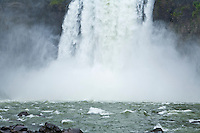 A tightly cropped view of the falling water and pool at the base of Snoqualmie Falls, Washington, USA