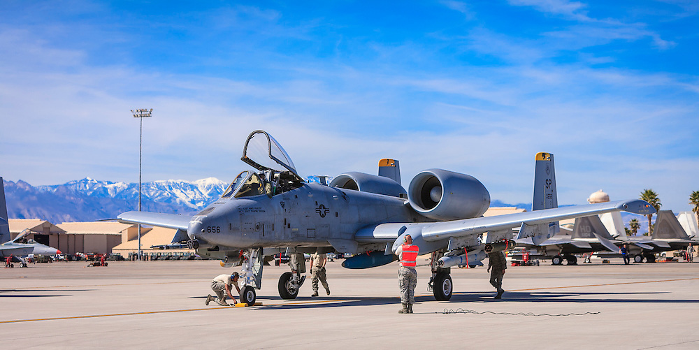 """Final checks on an A-10 """"Warthog"""", created just prior to departure at Nellis Air Force Base, near Las Vegas, Nevada.  <br /> <br /> Created by aviation photographer John Slemp of Aerographs Aviation Photography. Clients include Goodyear Aviation Tires, Phillips 66 Aviation Fuels, Smithsonian Air & Space magazine, and The Lindbergh Foundation.  Specialising in high end commercial aviation photography and the supply of aviation stock photography for advertising, corporate, and editorial use."""