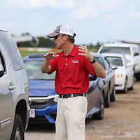 Shawn King of State Farm explains to a participant in Saturday's Defensive Driving class what the next course will be
