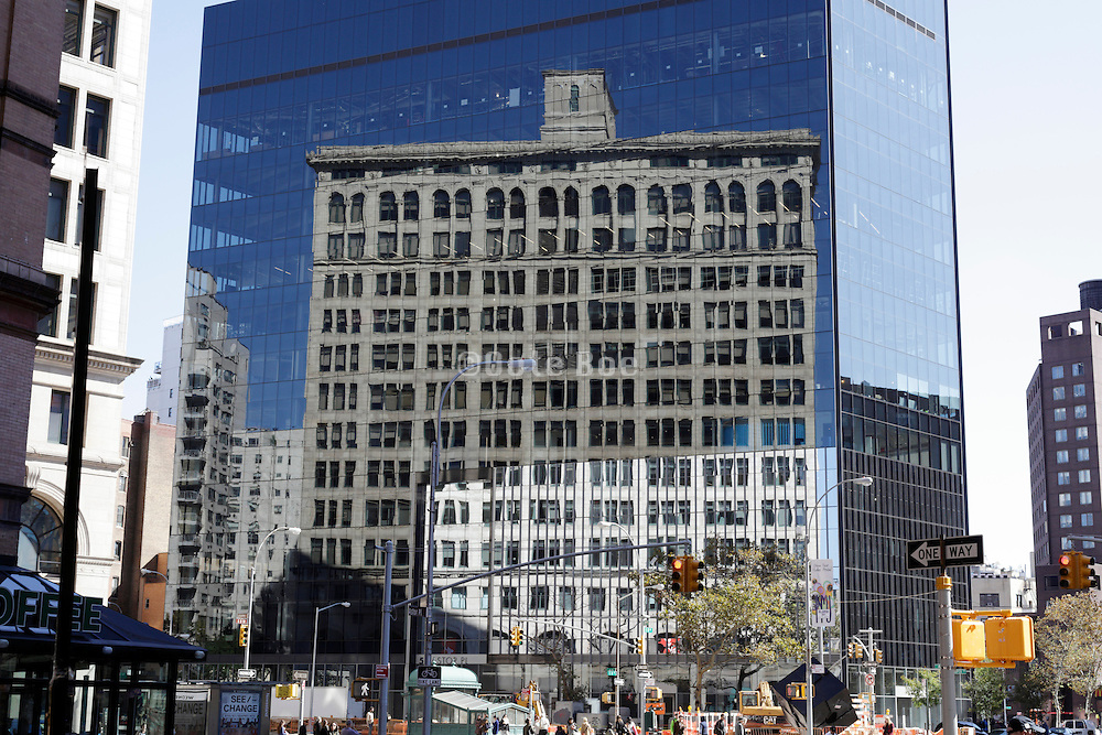 old building reflecting in a new glass highrise New York City