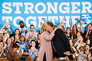 Hillary Clinton, presumptive 2016 Democratic presidential nominee, hugs Senator Tim Kaine (D-VA) at Northern Virginia Community College in Annandale, Va., U.S., on Thursday, July 14, 2016. Clinton and the former Virginia Governor discussed their shared commitment to building an America that is stronger together, while emphasizing that Donald Trump's divisive agenda would be dangerous for America. Kaine is considered to be the frontrunner for the Vice Presidential slot. Photographer: Pete Marovich/Bloomberg