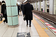 Tokyo subway with Tactile Ground Surface Indicators or TGSI tiles for the blind and people walking
