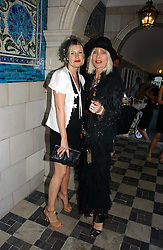 Left to right, SARA PARKER-BOWLES and VIRGINIA BATES at a party to celebrate Stephen Jones's 25 Years of Millinery held at Debenham House, 8 Addison Road, London W14 on 13th July 2006.<br />