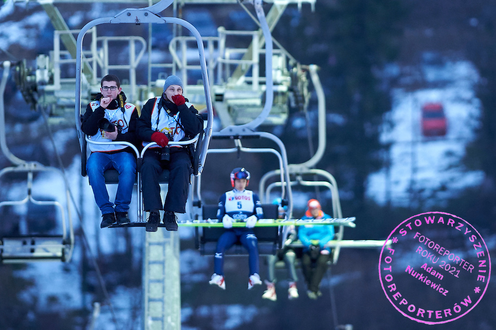 (R) Photographer Piotr Hawalej (Wrofoto Agency) sits in ski lift during FIS World Cup Ski Jumping competition in Wisla, Poland on January 15, 2015.<br /> <br /> Poland, Wisla, January 15, 2015.<br /> <br /> Picture also available in RAW (NEF) or TIFF format on special request.<br /> <br /> For editorial use only. Any commercial or promotional use requires permission.<br /> <br /> Mandatory credit:<br /> Photo by &copy; Adam Nurkiewicz / Mediasport