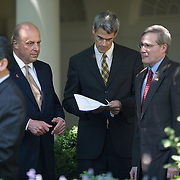 Deputy Secretary of State John Negroponte, Domestic Policy Advisor Karl Zinmeister, and National Security Advisor Stephen Hadley talk as Pres. Bush announces the President's Emergency Plan for AIDS Relief Wednesday, May 30, 2007, in the Rose Garden of the White House.  ..Photo by Khue Bui