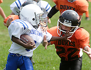 Middletown, NY - A Middletown player tries to push a Marlboro defender away while carrying the ball in an Orange County Youth Football League game at Watts Park on Sept. 9, 2007.