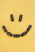 Car smiley face photo illustration with yellow background