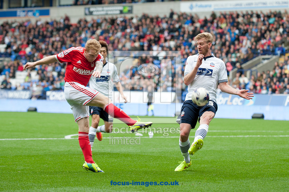 Chris Burke of Nottingham Forest hit a shot at goal during the Sky Bet Championship match at the Macron Stadium, Bolton<br /> Picture by Russell Hart/Focus Images Ltd 07791 688 420<br /> 16/08/2014