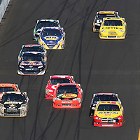 Sprint Cup Series driver Kurt Busch (22) leads the packs of 2 as they race during the Daytona 500 at Daytona International Speedway on February 20, 2011 in Daytona Beach, Florida. (AP Photo/Alex Menendez)