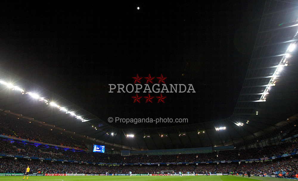 MANCHESTER, ENGLAND - Wednesday, December 7, 2011: Manchester City's players celebrate their first goal against FC Bayern Munchen under a full moon during the UEFA Champions League Group A match at the City of Manchester Stadium. (Pic by Vegard Grott/Propaganda)