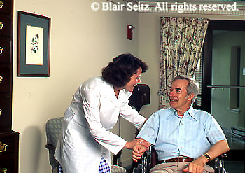 Active Aging Senior Citizens, Retired, Activities, Nurse Assists Single Man, Retirement Community, Wheelchair