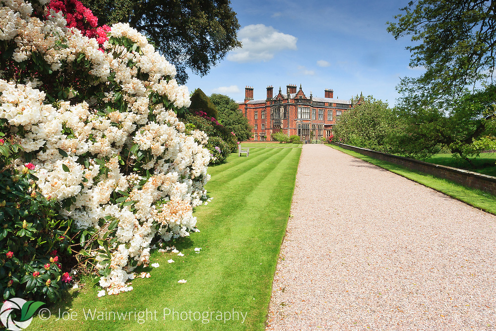 While the original Arley Hall, Cheshire, dated from the 15th and 16th centuries, the building seen here was built in the 1830s.  A glorious display of rhododendrons can be enjoyed here in May, although the garden is better known for its historic double herbaceous borders.