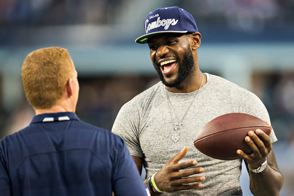 ARLINGTON, TX - SEPTEMBER 8:  LeBron James of the Miami Heat is greeted by Head Coach Jason Garrett of the Dallas Cowboys before a game against the New York Giants at AT&T Stadium on September 8, 2013 in Arlington, Texas.  The Cowboys defeated the Giants 31-36.  (Photo by Wesley Hitt/Getty Images) *** Local Caption *** LeBron James; Jason Garrett