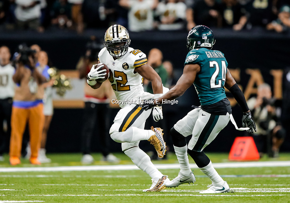 Nov 18, 2018; New Orleans, LA, USA; New Orleans Saints running back Mark Ingram II (22) runs from Philadelphia Eagles safety Corey Graham (24) during the first quarter at the Mercedes-Benz Superdome. Mandatory Credit: Derick E. Hingle-USA TODAY Sports