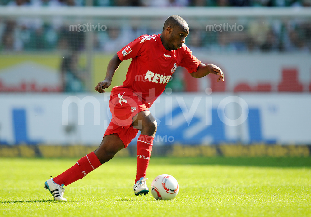 FUSSBALL   1. BUNDESLIGA   SAISON 2010/2010   31. Spieltag VfL Wolfsburg - 1. FC Koeln                                   24.04.2011 Reinhold YABO (1. FC Koeln) am Ball