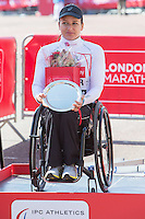Manuela Schar of Switzerland on the podium after the Women's Wheelchair race at the Virgin Money London Marathon 2014 at the finish line on Sunday 13 April 2014<br /> Photo: Dillon Bryden/Virgin Money London Marathon<br /> media@london-marathon.co.uk