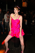 A cute girl dancing provocatively wearinga short pink dress. Anti-Social, London December 2006