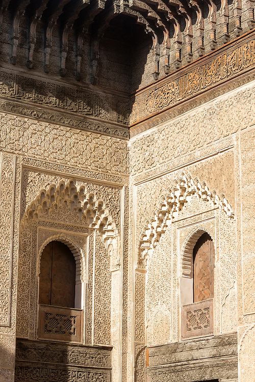 FEZ, MOROCCO - 1st DECEMBER 2016 - Detailed stone and wooden carvings on the walls in the courtyard at the Bou Inania Madrasa, Koranic School, Fez Medina, Middle Atlas Mountains, Morocco.