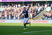 Millwall defender Shaun Hutchinson (4) celebrates after scoring a goal (1-1) during the EFL Sky Bet Championship match between Millwall and Queens Park Rangers at The Den, London, England on 21 September 2019.
