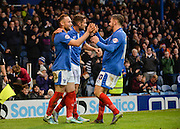 Portsmouth defender Ben Davies and Portsmouth striker Gareth Evans Portsmouth striker Marc McNulty celebrate ports mouths 2nd goal during the Sky Bet League 2 match between Portsmouth and Hartlepool United at Fratton Park, Portsmouth, England on 12 December 2015. Photo by Adam Rivers.