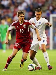 Ben Gibson of England closes down Yahuhen Lebedzeu of Belarus - Photo mandatory by-line: Matt McNulty/JMP - Mobile: 07966 386802 - 11/06/2015 - SPORT - Football - Barnsley - Oakwell Stadium - England U21 v Belarus U21 - International Friendly U21s