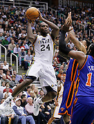 Utah Jazz forward Paul Millsap, left, attempts to pass the ball as New York Knicks forward Wilson Chandler, center, and Knicks center Ronny Turiaf, right, defend during the second half of an NBA basketball game in Salt Lake City, Wednesday Jan. 12, 2011. The Jazz defeated the Knicks 131-125. (AP Photo/Colin E Braley)