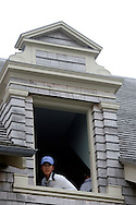 Michelle Wie of the US looks out the window of the clubhouse durring a delay due to fog during the first day of the US Women's Open Golf Championship at Newport Country Club in Newport Rhode Island, Thursday  29 June 2006