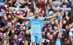 MANCHESTER, ENGLAND - Sunday, November 2, 2014: Manchester City's captain Vincent Kompany celebrates at the final whistle as his side beat Manchester United 1-0 during the Premier League match at the City of Manchester Stadium. (Pic by David Rawcliffe/Propaganda)