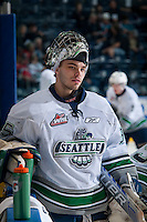 KELOWNA, CANADA - MARCH 18: Taran Kozun #35 of Seattle Thunderbirds stands at the bench during warm up against the Kelowna Rockets on March 18, 2015 at Prospera Place in Kelowna, British Columbia, Canada.  (Photo by Marissa Baecker/Shoot the Breeze)  *** Local Caption *** Taran Kozun;