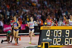 London, 2017 August 07. Faith Chepngetich Kipyegon, Kenya, wins the women's 1,500m final with Jennifer Simpson, USA, and Caster Semenya, South Africa, collapsing to the ground in third on day four of the IAAF London 2017 world Championships at the London Stadium. © Paul Davey.