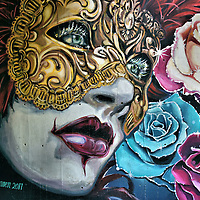 Venetian Theater Mask Mural at Kildonan Park in Winnipeg, Canada<br /> This colorful mural of a woman in a Venetian theater mask graces the entrance to the Rainbow Stage outdoor theater in Kildonan Park.  It was painted on 8,000 square feet of concrete in 2011 by Mandy Van Leeuwen and Michel Saint Hilaire.