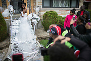Family and friends take photographs of Nailah Bradley on the front stairs of her South Shore home for her prom send-off party Saturday, May 17, 2014. (Brian Cassella/Chicago Tribune) B583716572Z.1  ....OUTSIDE TRIBUNE CO.- NO MAGS,  NO SALES, NO INTERNET, NO TV, CHICAGO OUT, NO DIGITAL MANIPULATION...