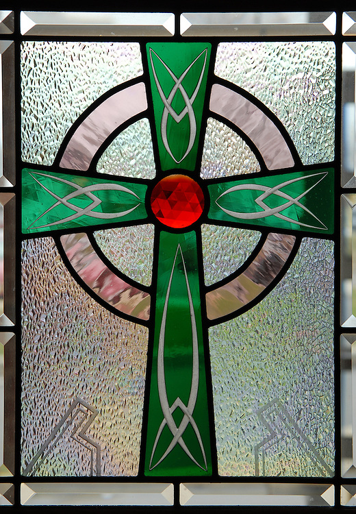 Image of a cross on a window in Milwaukee. (Photo by Sam Lucero)