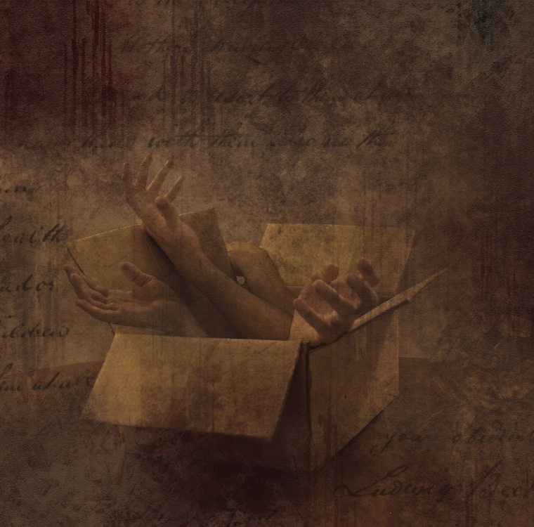 Limbs in a small box with montaged hand writing