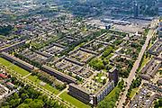 Nederland, Noord-Brabant, Eindhoven, 27-05-2013; stadsdeel Woensel-Noord, wijk Ontginning, buurt 't Hool. Boven in beeld winkelentrum Woensel.<br /> De woonbuurt met verschillende woningtypes is tussen 1968 en 1972 gerealiseerd en geldt als toonbeeld van de wederopbouw architectuur en stedenbouw. Architect Jaap Bakema.<br /> Residential area in Eindhoven with various housing types realized between 1968 and 1972. The design is considered a model of architecture and urban reconstruction. Architect Jaap Bakema.<br /> luchtfoto (toeslag op standard tarieven)<br /> aerial photo (additional fee required)<br /> copyright foto/photo Siebe Swart