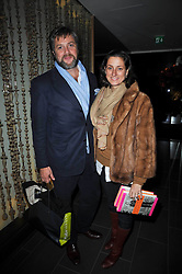 The 10th EARL OF ALBEMARLE and the COUNTESS OF ALBEMARLE at the launch of Nicky Haslam's autobiography Redeeming Features held at Aqua Nueva, 240 regent Street, London on 5th November 2009.