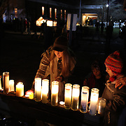 Candles alight as children and families pay their respects to a shrine at the Rose Lima church in Newtown Sandy Hook after yesterday's shootings at Sandy Hook Elementary School, Newtown, Connecticut, USA. 15th December 2012. Photo Tim Clayton