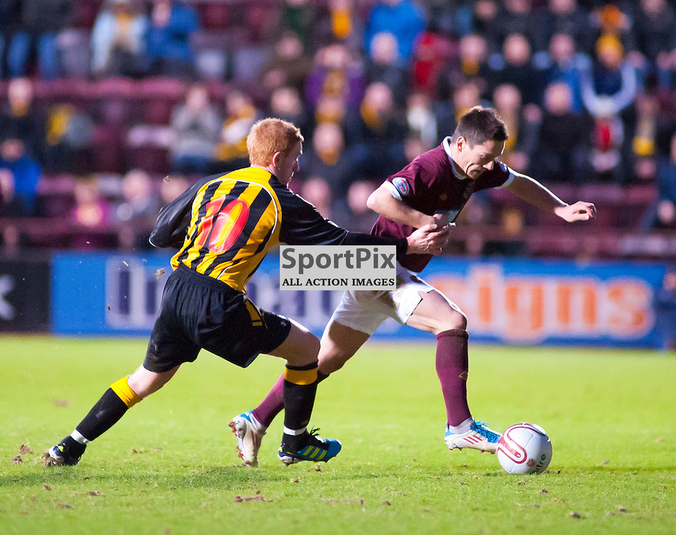 Hearts v Auchinleck Talbot, Tynecastle Stadium, Edinburgh, Colin Spence tries to pull back Ian Black
