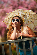 Portrait of a 16 year old teen girl with sunglasses and a parasol. Model released