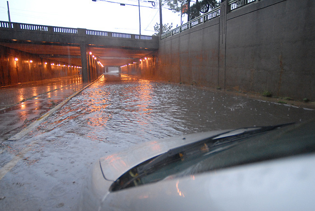 Atlanta experienced record breaking floods today after many days in a row of rain. This is the view from my car window this afternoon as I tried to get back to work after a photo shoot.