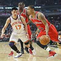 12 March 2012: Chicago Bulls point guard Derrick Rose (1) drives past New York Knicks point guard Jeremy Lin (17) during the first half of New York Knicks vs Chicago Bulls, at the United Center, Chicago, Illinois, USA.