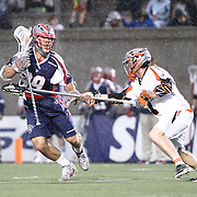 Paul Rabil #99 of the Boston Cannons keeps the ball from a member of Denver Outlaws during the game at Harvard Stadium on May 10, 2014 in Boston, Massachusetts. (Photo by Elan Kawesch)