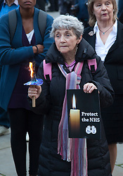 © Licensed to London News Pictures. 07/09/2011. London, UK. JOANNE SANDERSON, retired teacher. Save the NHS Demonstration coincided with the third reading of the Government's Health and Social Care Bill. Demonstrators marched across Westminster Bridge to the Houses of Parliament where they held a candle-lit vigil. The demonstration was supported by Unite the Union, Keep our NHS Private, the Health Worker Network, Right to Work, Unison and the Tradeunion Congress. Photo credit: Bettina Strenske/LNP