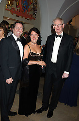 Left to right, DR LIAM FOX, his fiance JESME BAIRD and SIR STUART WHEELER at a dinner attended by the Conservative leader Michael Howard and David Davis and David Cameron held at the Banqueting Hall, Whitehall, London on 29th November 2005.<br />