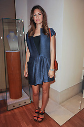 DASHA ZHUKOVA at a party to celebrate the B.zero 1 design by Anish Kapoor held at Bulgari, 168 New Bond Street, London n 2nd June 2010.