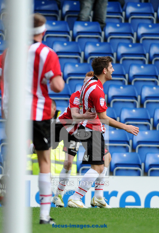 Picture by Graham Crowther/Focus Images Ltd. 07763140036.26/11/11 .Chad Evans of Sheffield United celebrates his goal with team mate Stephen Quinn during the Npower League 1 game at the B2net stadium, Chesterfield.